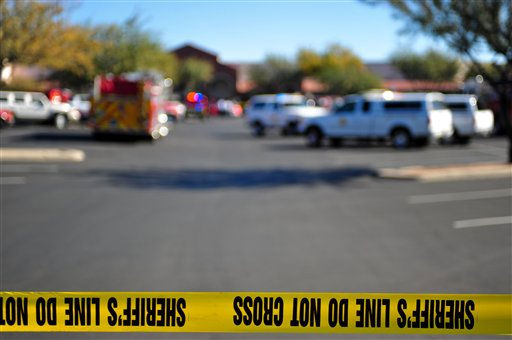 "<div class=""meta ""><span class=""caption-text "">Emergency officials work at the scene of a shooting that authorities claim involved Rep. Gabrielle Giffords, D-Ariz., Saturday, Jan. 8, 2011, at a Safeway grocery store in Tucson, Ariz. (AP Photo/Chris Morrison) (AP Photo/ Chris Morrison)</span></div>"