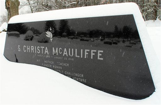 In this photo taken Friday, Jan. 21, 2011 in Concord, N.H., snow falls on he gravesite of high school teacher Christa McAuliffe.  McAuliffe and the rest of the crew of the space shuttle Challenger died when the shuttle exploded in 1986. Before the world knew her as &#34;the teacher in space,&#34; McAuliffe was known as a popular, energetic teacher who took a great interest in her students.  <span class=meta>(AP Photo&#47; Jim Cole)</span>