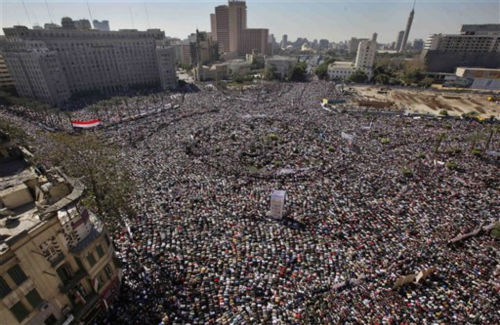 Tens of thousands of Egyptians pray and celebrate the fall of the regime of former President Hosni Mubarak, and to maintain pressure on the current military rulers, in Tahrir Square in downtown Cairo, Egypt Friday, Feb. 18, 2011. <span class=meta>(AP Photo&#47; Ben Curtis)</span>