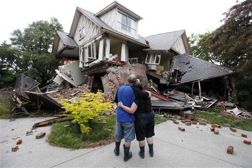 "<div class=""meta image-caption""><div class=""origin-logo origin-image ""><span></span></div><span class=""caption-text"">Murray and Kelly James look at their destroyed house in central Christchurch, New Zealand, Wednesday, Feb. 23, 2011. Tuesday's magnitude-6.3 temblor collapsed buildings, caused extensive other damage and killed dozens of people in the city.  (AP Photo/ Mark Baker)</span></div>"