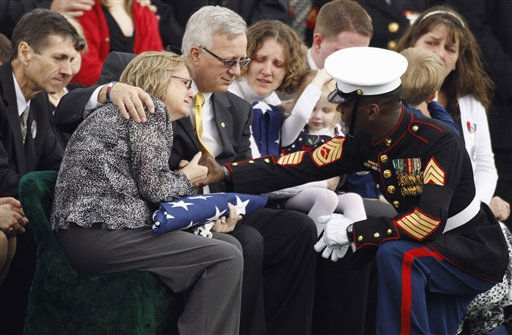 "<div class=""meta ""><span class=""caption-text "">Marine Corps Funeral Director Gunnery Sgt. William J. Dixon, right, delivers  condolences to the Pyeatt family, from left,  Cynthia Pyeatt, her husband Lon Pyeatt, and their daughter Emily Smalley, during funeral services for their son U.S. Marine Sgt. Lucas T. Pyeatt at Arlington National Cemetery in Arlington, Va., Monday, Feb. 28, 2011. Pyeatt, 24, of West Chester, Ohio, was killed Feb. 5th while conducting combat operations in Helmand province, Afghanistan.   (AP Photo/ Alex Brandon)</span></div>"