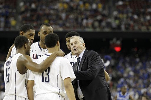 "<div class=""meta ""><span class=""caption-text "">Connecticut head coach Jim Calhoun huddles with the team during the second half of a men's NCAA Final Four semifinal college basketball game against Kentucky Saturday, April 2, 2011, in Houston. (AP Photo/Eric Gay) (AP Photo/ Eric Gay)</span></div>"