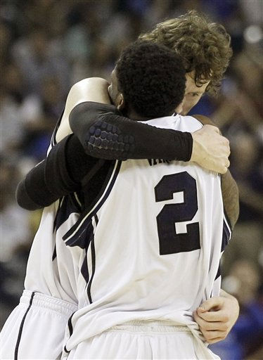 Butler&#39;s Matt Howard and Shawn Vanzant &#40;2&#41; embrace after their team beat Virginia Commonwealth 70-62 at a men&#39;s NCAA Final Four semifinal college basketball game Saturday, April 2, 2011, in Houston. &#40;AP Photo&#47;Eric Gay&#41; <span class=meta>(AP Photo&#47; Eric Gay)</span>