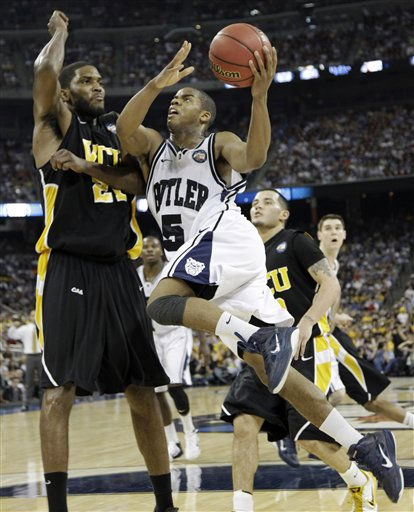 Butler&#39;s Ronald Nored shoots as Virginia Commonwealth&#39;s Jamie Skeen defends during the second half of a men&#39;s NCAA Final Four semifinal college basketball game Saturday, April 2, 2011, in Houston. &#40;AP Photo&#47;David J. Phillip&#41; <span class=meta>(AP Photo&#47; David J. Phillip)</span>