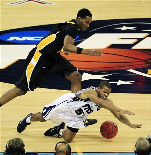 Butler&#39;s Ronald Nored, goes down as he and  Virginia Commonwealth&#39;s Juvonte Reddic go after the ball during the second half of a men&#39;s NCAA Final Four semifinal college basketball game Saturday, April 2, 2011, in Houston. &#40;AP Photo&#47;Mark Humphrey&#41; <span class=meta>(AP Photo&#47; Mark Humphrey)</span>