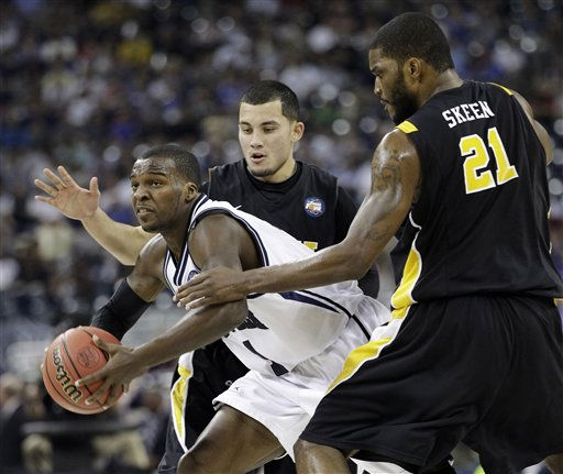 Butler&#39;s Shelvin Mack tries to drive between Virginia Commonwealth&#39;s Joey Rodriguez and Jamie Skeen &#40;21&#41; during the first half of a men&#39;s NCAA Final Four semifinal college basketball game Saturday, April 2, 2011, in Houston. &#40;AP Photo&#47;Eric Gay&#41; <span class=meta>(AP Photo&#47; Eric Gay)</span>