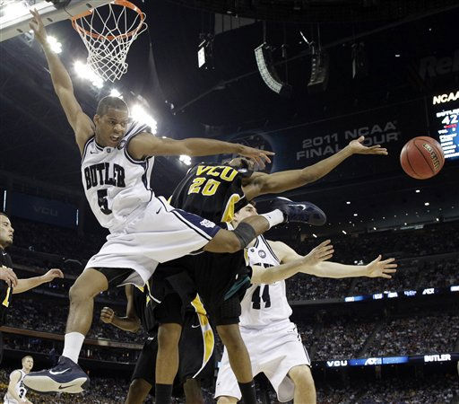 "<div class=""meta ""><span class=""caption-text "">Butler's Ronald Nored (5) Virginia Commonwealth's Bradford Burgess and Andrew Smith (44) go for the ball during the second half of a men's NCAA Final Four semifinal college basketball game Saturday, April 2, 2011, in Houston. (AP Photo/David J. Phillip) (AP Photo/ David J. Phillip)</span></div>"