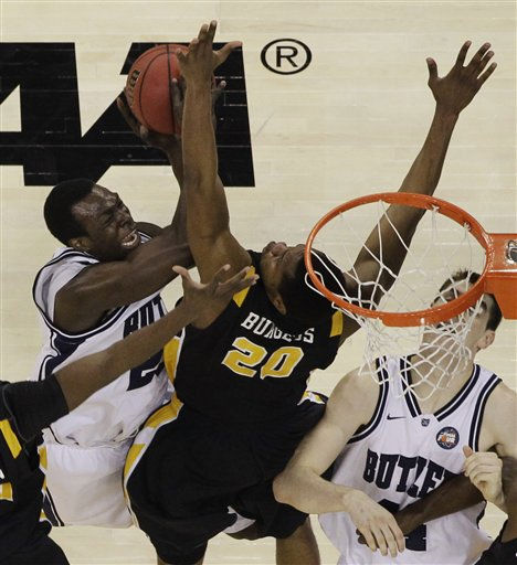 Virginia Commonwealth&#39;s Bradford Burgess &#40;20&#41; blocks an attempt by Butler&#39;s Khyle Marshall during the first half of a men&#39;s NCAA Final Four semifinal college basketball game Saturday, April 2, 2011, in Houston. Right is Butler&#39;s Chrishawn Hopkins. &#40;AP Photo&#47;David J. Phillip&#41; <span class=meta>(AP Photo&#47; David J. Phillip)</span>