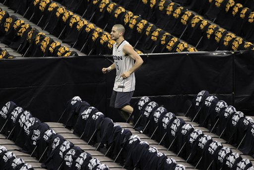 "<div class=""meta ""><span class=""caption-text "">A Connecticut student runs to his seat before a men's NCAA Final Four semifinal college basketball game between UConn and Kentucky Saturday, April 2, 2011, in Houston. (AP Photo/Mark Humphrey) (AP Photo/ Mark Humphrey)</span></div>"