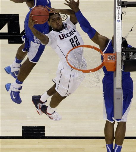 Connecticut&#39;s Roscoe Smith &#40;22&#41; goes up to score against Kentucky players during the second half of a men&#39;s NCAA Final Four semifinal college basketball game Saturday, April 2, 2011, in Houston. &#40;AP Photo&#47;David J. Phillip&#41; <span class=meta>(AP Photo&#47; David J. Phillip)</span>