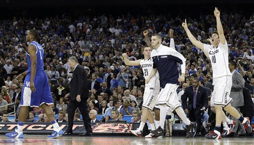 Connecticut players react to beating Kentucky 56-55 as Darius Miller, left, leaves the court after a men&#39;s NCAA Final Four semifinal college basketball game Saturday, April 2, 2011, in Houston. &#40;AP Photo&#47;Eric Gay&#41; <span class=meta>(AP Photo&#47; Eric Gay)</span>