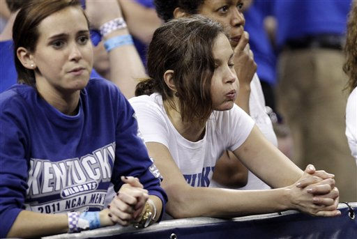 Actress and Kentucky fan Ashley Judd reacts in the final moments as Kentucky loses to Connecticut 56-55 at a men&#39;s NCAA Final Four semifinal college basketball game Saturday, April 2, 2011, in Houston. &#40;AP Photo&#47;Charlie Neibergall&#41; <span class=meta>(AP Photo&#47; Charlie Neibergall)</span>