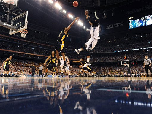Butler's Shawn Vanzant shots as Virginia Commonwealth's Brandon Rozzell defends during the second half of a men's NCAA Final Four semifinal college basketball game Saturday, April 2, 2011, in Houston. Butler won 70-62. (AP Photo/Rich Clarkson/NCAA Photos, Pool)