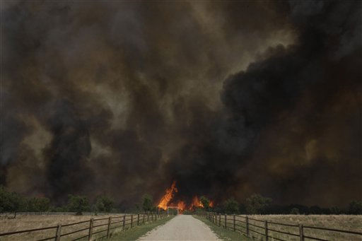 "<div class=""meta ""><span class=""caption-text "">Smoke rises from an uncontrolled wildfire burning near Possum Kingdom, Texas, Tuesday, April 19, 2011.   (AP Photo/ LM Otero)</span></div>"