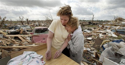 "<div class=""meta image-caption""><div class=""origin-logo origin-image ""><span></span></div><span class=""caption-text"">Beverly Winans hugs her daughter Debbie Spurlin while salvaging items from Winans' devastated home in Joplin, Mo. Wednesday, May 25, 2011. Winans and her husband rode out the EF-5 tornado by hiding under a bed in the home. The tornado tore through much of the city Sunday, damaging a hospital and hundreds of homes and businesses and killing at least 123 people.   (AP Photo/ Charlie Riedel)</span></div>"