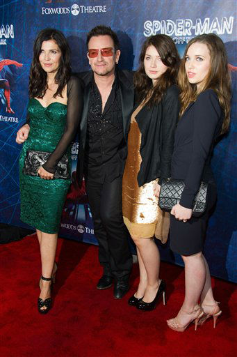 "<div class=""meta image-caption""><div class=""origin-logo origin-image ""><span></span></div><span class=""caption-text"">Bono and his wife Alison Hewson arrive with their daughters Memphis Eve and Jordan at the opening night performance of the Broadway musical ""Spider-Man Turn Off the Dark"" in New York, Tuesday, June 14, 2011. (AP Photo/Charles Sykes)</span></div>"