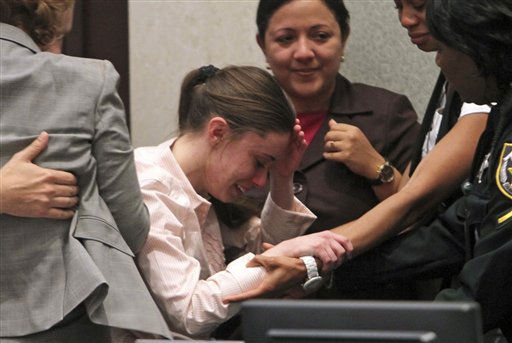 "<div class=""meta image-caption""><div class=""origin-logo origin-image ""><span></span></div><span class=""caption-text"">Casey Anthony, center, is overcome with emotion following her acquittal of murder charges at the Orange County Courthouse in Orlando, Fla., Tuesday, July 5, 2011. Anthony had been charged with killing her daughter, Caylee.    (AP Photo/ Red Huber)</span></div>"