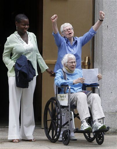 Phyllis Siegel, 77, arms raised, and Connie Kopelov, 85, in wheelchair, both of New York, celebrate after becoming the first same-sex couple to get married at the Manhattan City Clerk&#39;s office, Sunday, July 24, 2011, in New York.   <span class=meta>(AP Photo&#47; Jason DeCrow)</span>