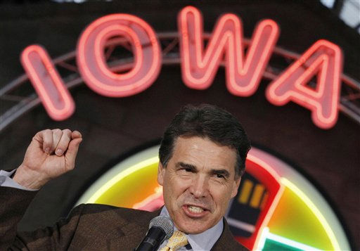 Republican presidential candidate, Texas Gov. Rick Perry makes a campaign stop at the Iowa 80 Group in Walcott, Iowa, Tuesday, Aug. 16, 2011.  <span class=meta>(AP Photo&#47; Charles Dharapak)</span>