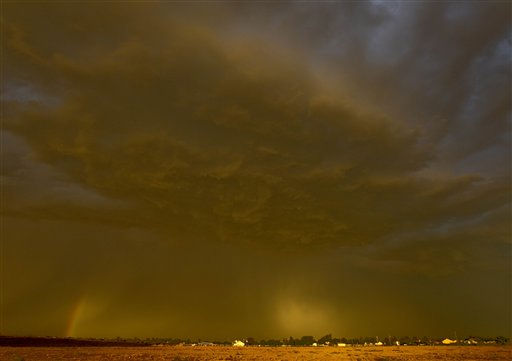 "<div class=""meta image-caption""><div class=""origin-logo origin-image ""><span></span></div><span class=""caption-text"">A dust storm hovers over Queen Creek, Ariz. Thursday, Aug. 18, 2011. The dust storm, also known as a haboob in Arabic and around Arizona, swept through Pinal County and headed northeast, reaching Phoenix at about 6 p.m. It was the third major dust storm to hit the Phoenix metro area since last month. (AP Photo/ Matt York)</span></div>"