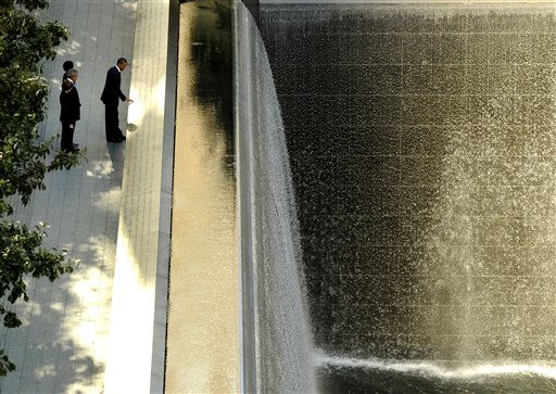 "<div class=""meta image-caption""><div class=""origin-logo origin-image ""><span></span></div><span class=""caption-text"">President Barack Obama, foreground, runs his hand along the names on the Sept. 11 memorial as former President George W. Bush, Laura Bush and Michelle Obama look on during a visit to the memorial during the 10th anniversary ceremony at the site of the World Trade Center Sunday, Sept. 11, 2011, in New York.   (AP Photo/ Timothy A. Clary)</span></div>"