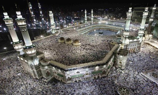 "<div class=""meta ""><span class=""caption-text "">Tens of thousands of Muslim pilgrims moving around the Kaaba, the black cube seen at center, inside the Grand Mosque, during the annual Hajj in Mecca, Saudi Arabia, Monday, Oct. 31, 2011. The annual Islamic pilgrimage draws 2.5 million visitors each year, making it the largest yearly gathering of people in the world. The Hajj will start on 5 November.  (AP Photo/ Hassan Ammar)</span></div>"
