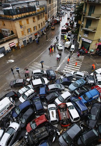 Cars, some overturned, that were swept into a pile by Friday&#39;s torrential rains are seen on a street in Genoa, Italy Saturday, Nov. 5, 2011. Italy&#39;s Premier Silvio Berlusconi says improper construction in flood plains was partly to blame for devastating floods that have killed at least six people in the port city of Genoa. Torrential rains lashing Genoa and Italy&#39;s western coast on Friday triggered flash floods that broke the banks of at least two rivers.  <span class=meta>(AP Photo&#47; Antonio Calanni)</span>