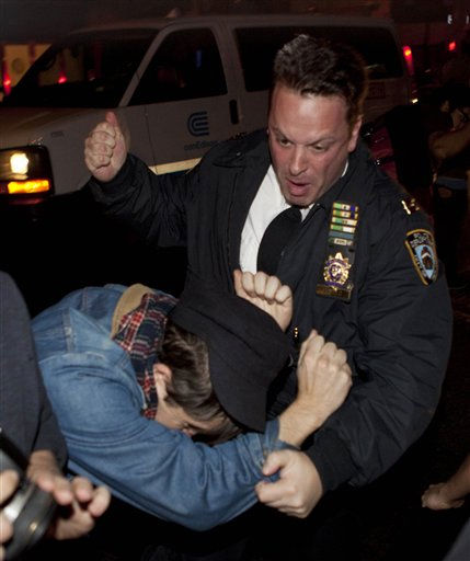"<div class=""meta ""><span class=""caption-text "">An Occupy Wall Street protestor draws contact from a police officer near Zuccotti Park after being ordered to leave the longtime encampment in New York, Tuesday, Nov. 15, 2011, in New York, after police ordered demonstrators to leave their encampment in Zuccotti Park. At about 1 a.m. Tuesday, police handed out notices from the park's owner, Brookfield Office Properties, and the city saying that the park had to be cleared because it had become unsanitary and hazardous. Protesters were told they could return, but without sleeping bags, tarps or tents.  (AP Photo/ John Minchillo)</span></div>"