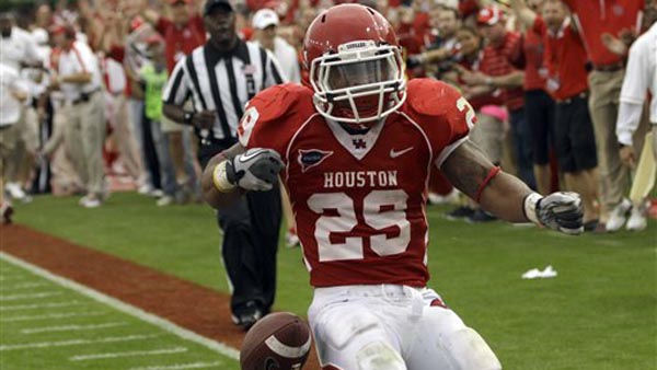 Houston&#39;s Michael Hayes &#40;29&#41; reacts after a 36-yard touchdown run during the second quarter of an NCAA college football game against SMU, Saturday, Nov. 19, 2011, in Houston. &#40;AP Photo&#47;David J. Phillip&#41; <span class=meta>(AP Photo&#47; David J. Phillip)</span>