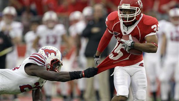 SMU defensive back Chris Banjo &#40;23&#41; grabs the jersey of Houston wide receiver Tyron Carrier &#40;35&#41; as he tackles him during the first quarter of an NCAA college football game Saturday, Nov. 19, 2011, in Houston. &#40;AP Photo&#47;David J. Phillip&#41; <span class=meta>(AP Photo&#47; David J. Phillip)</span>