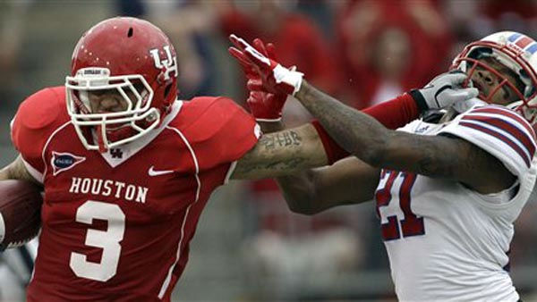 Houston wide receiver Justin Johnson &#40;3&#41; pushes the face mask of SMU defensive back Kenneth Acker &#40;21&#41; after catching a pass for a first down during the first quarter of an NCAA college football game on Saturday, Nov. 19, 2011, in Houston. &#40;AP Photo&#47;David J. Phillip&#41; <span class=meta>(AP Photo&#47; David J. Phillip)</span>