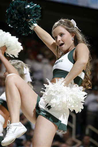 "<div class=""meta ""><span class=""caption-text "">Michigan State cheerleader Taylor Young performs during an NCAA college basketball game against Ohio State, Sunday, March 4, 2012, in East Lansing, Mich.  (AP Photo/ Al Goldis)</span></div>"