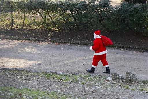 A man dressed as Santa Claus walks in a park in downtown Milan, Italy, two days ahead of Christmas Day, Friday, Dec. 23, 2011. &#40;AP Photo&#47;Antonio Calanni&#41; <span class=meta>(AP Photo&#47; Antonio Calanni)</span>