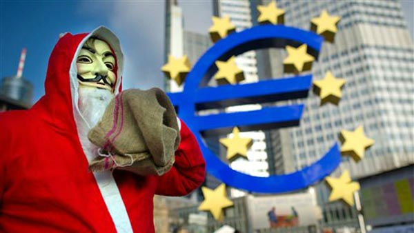 An activist of the German Occupy Movement dressed as Santa Claus,  walks near the euro sign sculpture at the European Central Bank &#40;ECB&#41; in Frankfurt, central Germany, Saturday Dec. 24, 2011.  &#40;AP Photo&#47;dapd&#47;Thomas Lohnes&#41; <span class=meta>(AP Photo&#47; Thomas Lohnes)</span>
