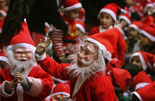 "<div class=""meta ""><span class=""caption-text "">Students dressed as Santa Claus sing during Christmas celebrations at a school in Jammu, India, Saturday, Dec.24, 2011. Christmas Day is observed as a national holiday in India. (AP Photo/Channi Anand) (AP Photo/ Channi Anand)</span></div>"