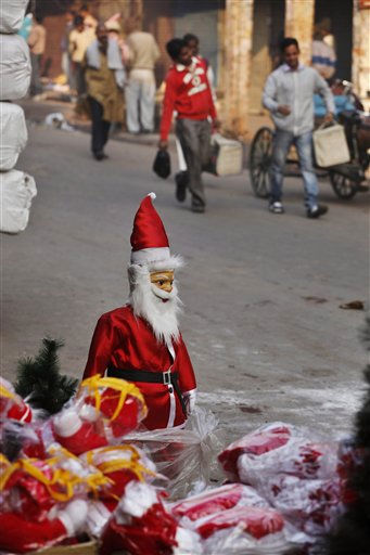 Figures of Santa Claus and other Christmas decorations are displayed for sale at a shot in New Delhi, India, Saturday, Dec. 24, 2011. Christmas Day is observed as a national holiday in India. &#40;AP Photo&#47;Rajesh Kumar Singh&#41; <span class=meta>(AP Photo&#47; Rajesh Kumar Singh)</span>