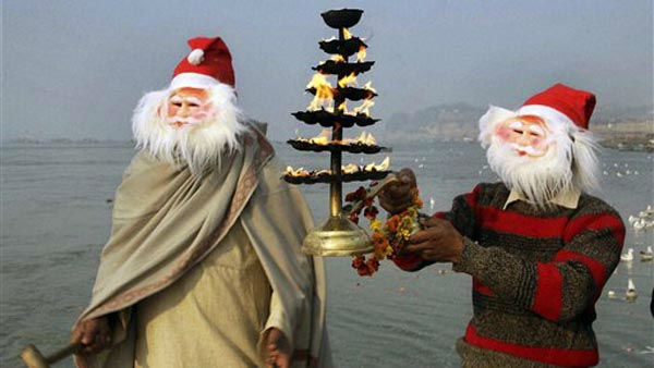Indian devotees dressed as Santa Claus pray at Sangam, confluence of three rivers, the Ganga, the Yamuna and mythical Saraswati on the eve of Christmas festival in Allahabad, India, Saturday, Dec. 24, 2011. Christmas Day is observed as a national holiday in India. &#40;AP Photo&#41; INDIA OUT <span class=meta>(AP Photo&#47; Anonymous)</span>