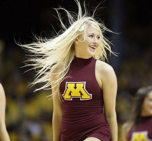 "<div class=""meta ""><span class=""caption-text "">Minnesota cheerleader performs against Illinois during an NCAA college basketball game, Saturday, Jan. 28, 2012 in Minneapolis.  (AP Photo/ PAUL BATTAGLIA)</span></div>"