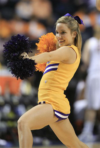 An LSU cheerleader performs in an NCAA college basketball game against Arkansas at the women&#39;s Southeastern Conference tournament on Friday, March 2, 2012, in Nashville, Tenn. LSU won 41-40. Photo&#47;Mark Humphrey&#41; <span class=meta>(AP Photo&#47; Mark Humphrey)</span>