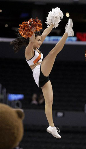 Oregon cheerleader performs during the first half of an NCAA college basketball game against Washington State at the Pac-12 conference championship in Los Angeles, Wednesday, March 7, 2012.  <span class=meta>(AP Photo&#47; Jae Hong)</span>