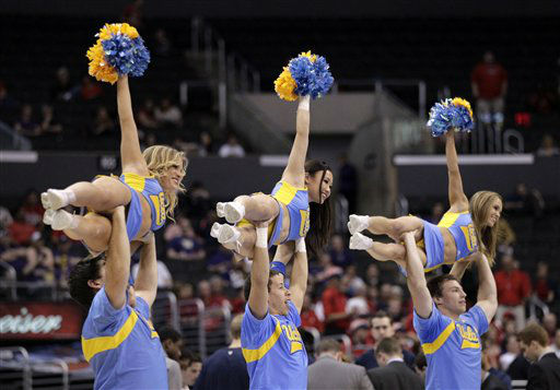 "<div class=""meta image-caption""><div class=""origin-logo origin-image ""><span></span></div><span class=""caption-text"">UCLA cheerleader perform during the first half of an NCAA college basketball game against Arizona at the Pac-12 conference championship in Los Angeles, Thursday, March 8, 2012.  (AP Photo/ Jae C. Hong)</span></div>"
