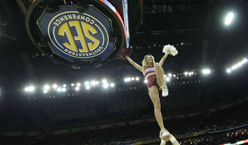 An Arkansas cheerleader performs during the second half of an NCAA college basketball game against LSU in the first round of the 2012 Southeastern Conference basketball tournament at the New Orleans Arena in New Orleans, Thursday, March 8, 2012.   <span class=meta>(AP Photo&#47; Gerald Herbert)</span>