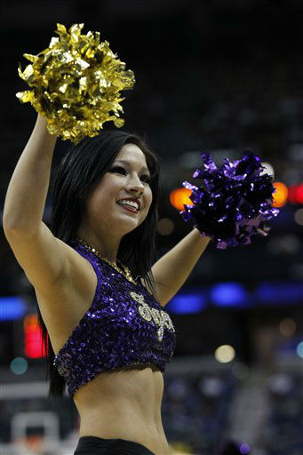 An LSU cheerleader performs during the second half of an NCAA college basketball game against Arkansas in the first round of the 2012 Southeastern Conference basketball tournament at the New Orleans Arena in New Orleans, Thursday, March 8, 2012. LSU beat Arkansas 70-54.  <span class=meta>(AP Photo&#47; Bill Haber)</span>