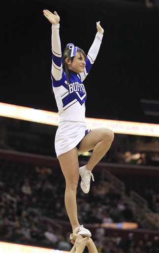 A Buffalo cheerleader balances during an NCAA college basketball game Between Buffalo and Ohio in the Mid-American Conference men&#39;s semifinals Friday, March 9, 2012, in Cleveland.  <span class=meta>(AP Photo&#47; Tony Dejak)</span>
