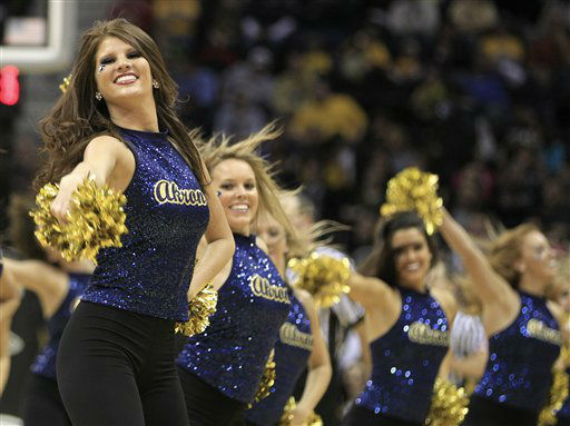 "<div class=""meta ""><span class=""caption-text "">Akron cheerleaders perform during a timeout during an NCAA college basketball game against Kent State in the Mid-American Conference men's semifinals Friday, March 9, 2012, in Cleveland.  (AP Photo/ Tony Dejak)</span></div>"