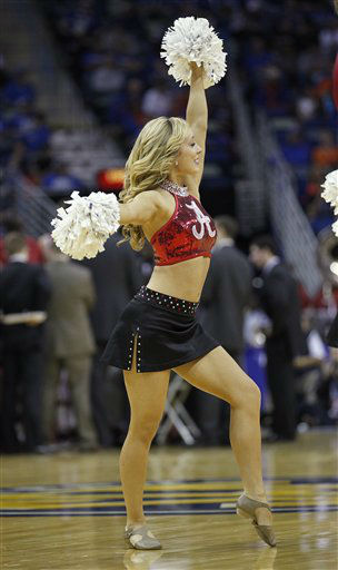 An Alabama cheerleader performs during the first half of an NCAA college basketball game against Florida in the second round of the 2012 Southeastern Conference tournament at the New Orleans Arena in New Orleans, Friday, March 9, 2012.  <span class=meta>(AP Photo&#47; Bill Haber)</span>