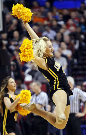 A New Mexico cheerleader leaps in the air during the first half of their NCAA tournament second-round college basketball game against Long Beach State in Portland, Ore., Thursday, March 15, 2012.  <span class=meta>(AP Photo&#47; Don Ryan)</span>