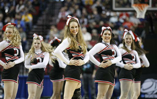"<div class=""meta ""><span class=""caption-text "">Davidson's cheerleaders perform during the first half of an NCAA tournament second-round college basketball game with Louisville, in Portland, Ore., Thursday, March 15, 2012.  (AP Photo/ Rick Bowmer)</span></div>"