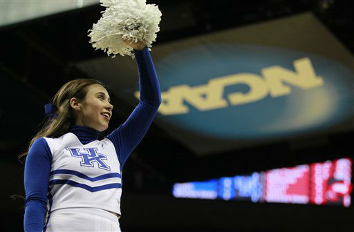 A Kentucky cheerleader performs in the first half of their NCAA tournament second-round college basketball game against Western Kentucky in Louisville, Ky., Thursday, March 15, 2012.  <span class=meta>(AP Photo&#47; John Bazemore)</span>