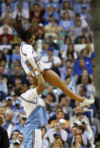 "<div class=""meta image-caption""><div class=""origin-logo origin-image ""><span></span></div><span class=""caption-text"">North Carolina cheerleaders perform  during the first half of a Midwest Regional NCAA tournament second-round college basketball game against Vermont in Greensboro, N.C., Friday, March 16, 2012.  (AP Photo/ Gerry Broome)</span></div>"